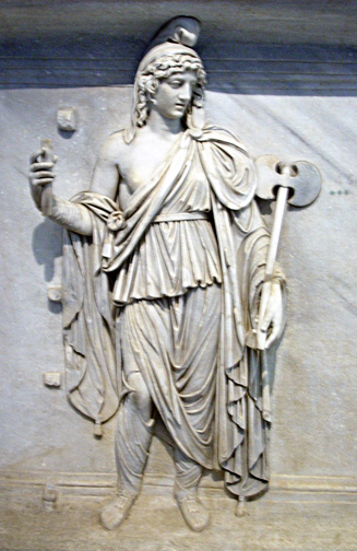 draped woman holding double axe and another object, now broken