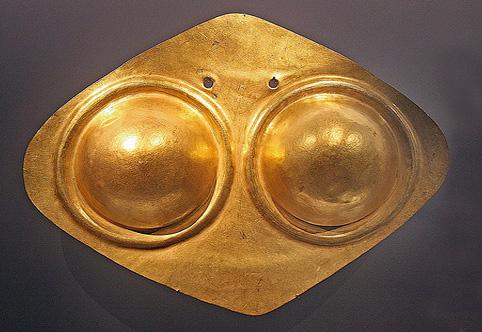 diamond-shaped breastplate with female breasts