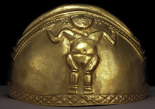 hemispheric helmet of beaten gold with female figure in relief holding ritual staffs
