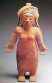 woman with outstretched hands, in reddish clay