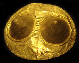 golden pectoral with female breasts