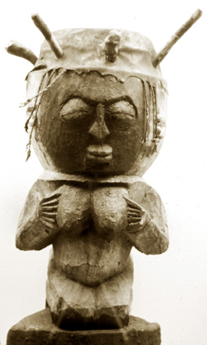 drum carved as a woman holding her breasts