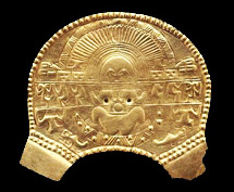 golden breastplate with birthing goddess