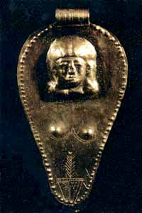 another golden triangular-ovoid amulet with woman's face and vulva